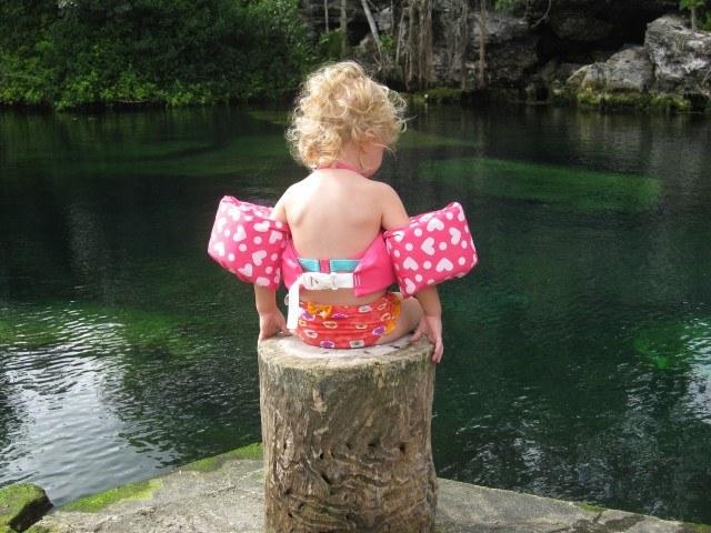 Contemplating a Plunge in Cenote Cristalino, Playa del Carmen