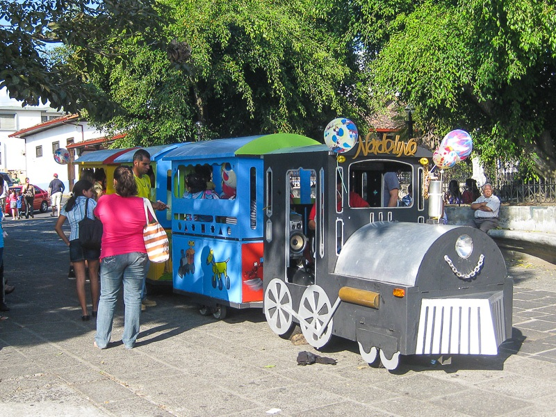 Catching the kids train in Parque Central Heredia Costa Rica
