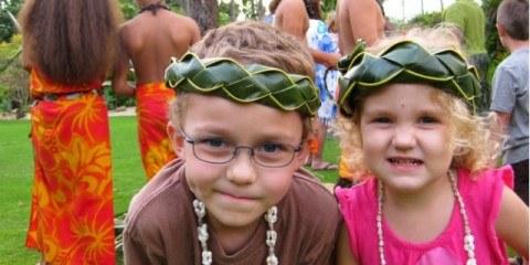 Happy at the Hale Koa Luau in Oahu