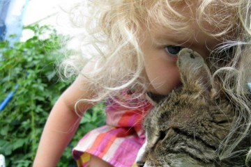 Little Girl and Tabby Cat in the Garden