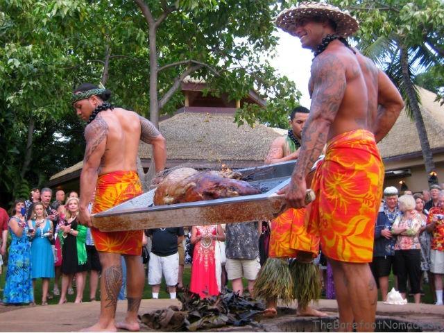Removing the Roast Pig from the Imu Hale Koa Luau Waikiki Oahu Hawaii 640