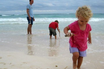 Playing in the waves at Tulum Kids Activities