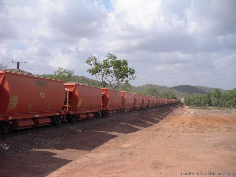 Red Train on Highway by Darwin Australia