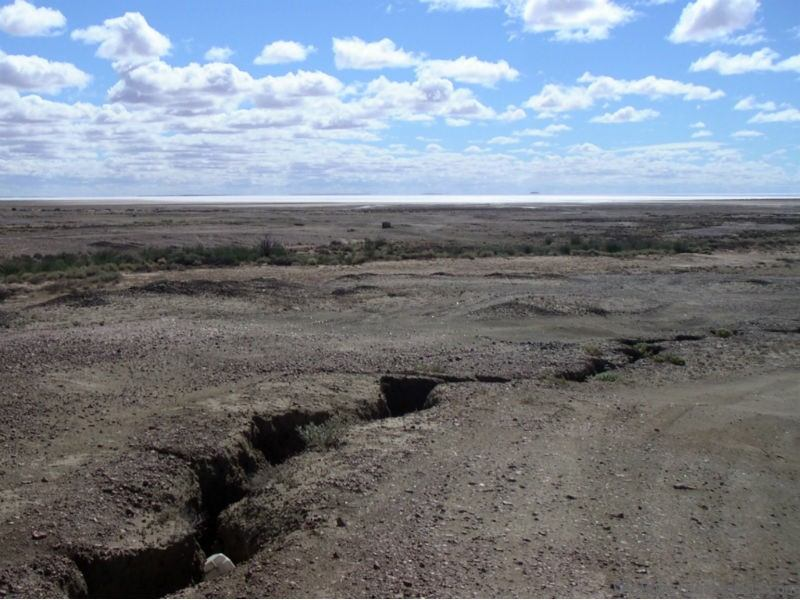 Saltwater flat of Lake Eyre South shimmering in the distance Oodnadatta Track Australia