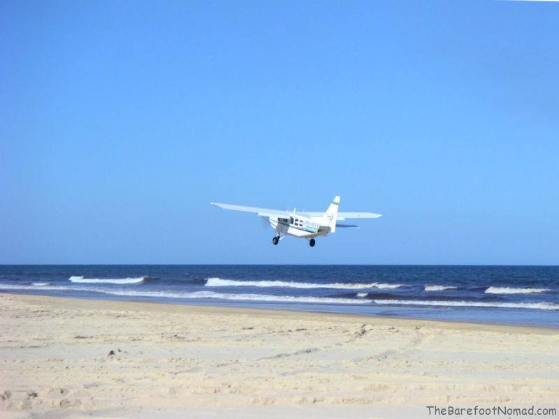 Airplane Landing on 75 Mile Beach
