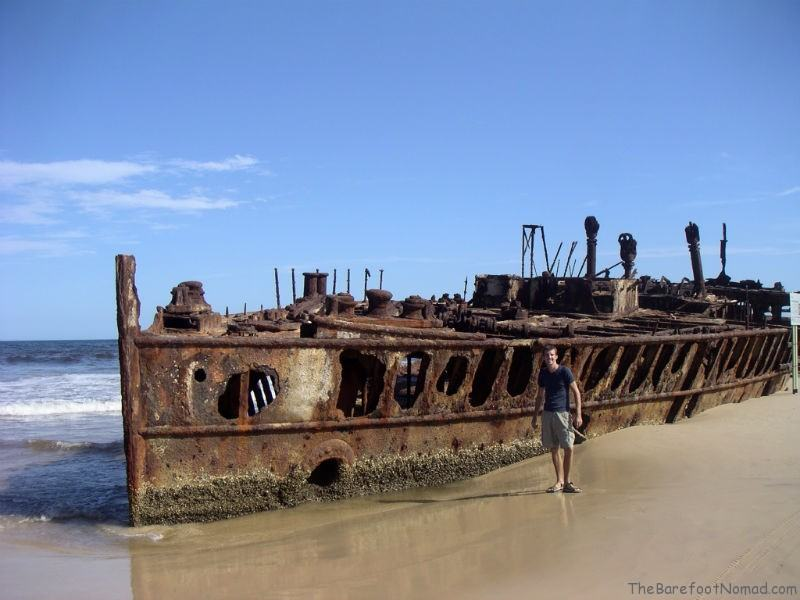 Charles by the rusting Maheno shipwreck Fraser Island Australia sand island