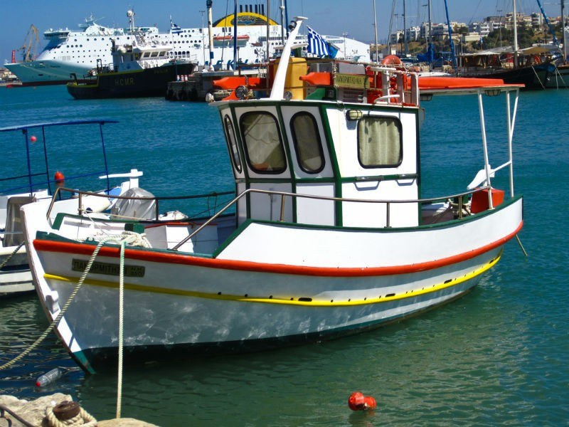 Little white fishing boat at Heraklion Crete