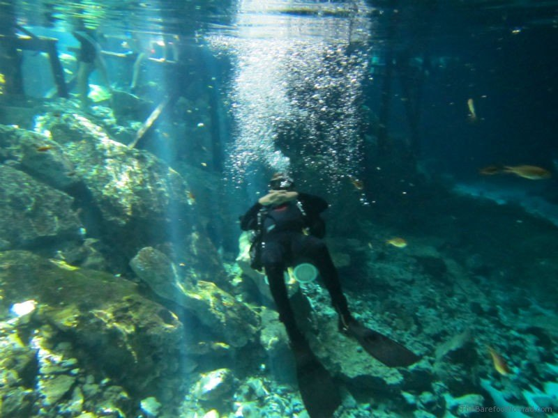 Dos Ojos Cenote Diver Relaxing on his back Bubbles Mexico