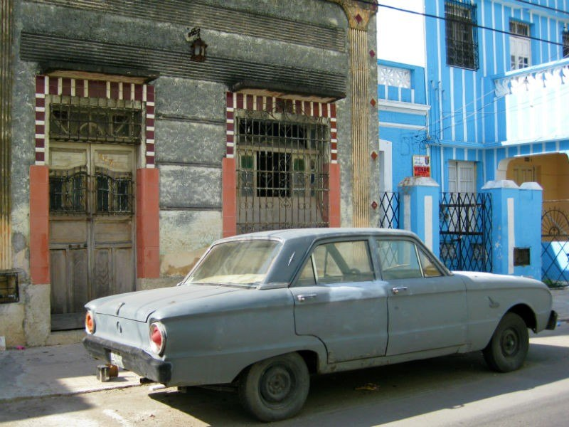 Merida Mexico colonial houses and grey car