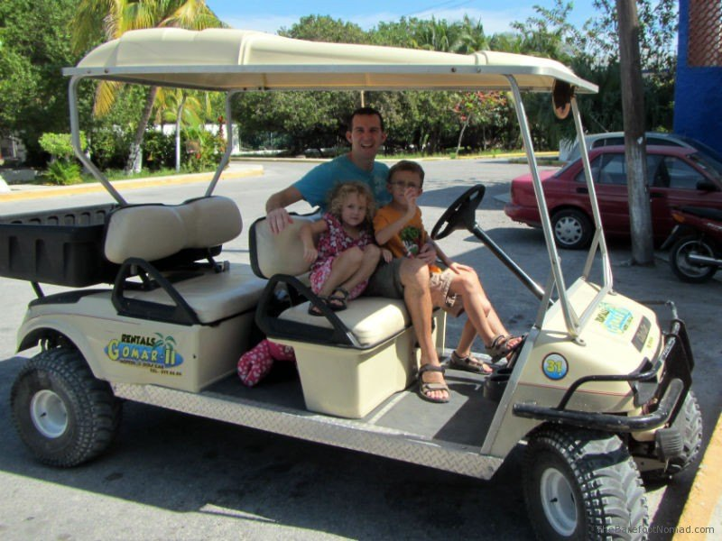 Charles Kosman and kids on a golf cart