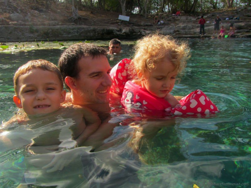 A dip in the Xlakan cenote in Dzibilchaltun