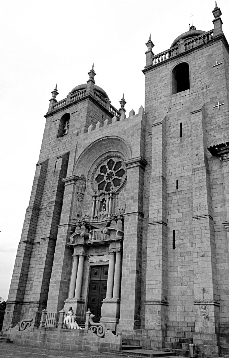Bride on steps of Cathedral Se Porto Portugal black and white
