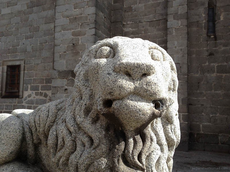 A Stone Lion in front of the Cathedral of Avila, Spain