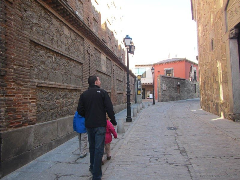 Charles Kosman and the kids walking down a lane in Avila, Spain