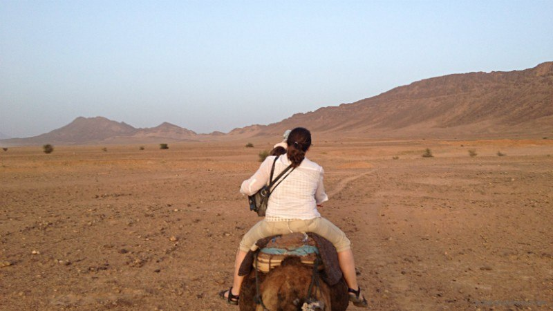 Woman on Camel ride morocco