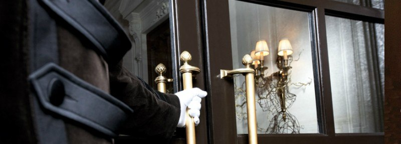 Doorman in White Gloves