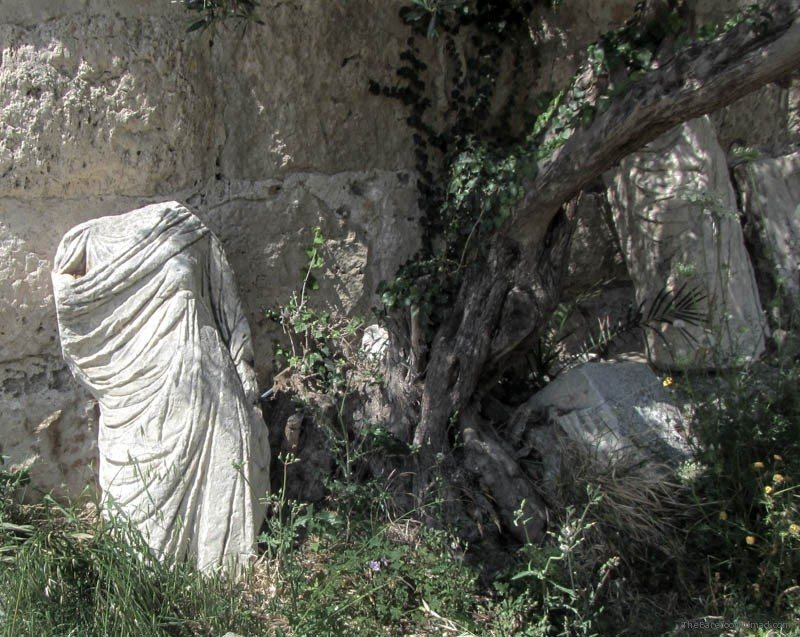 Statue abandoned by the trees Kos Castle Greece