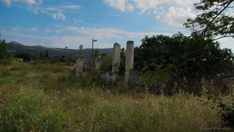 Peeking at Casa Romana Kos Greece through the fence