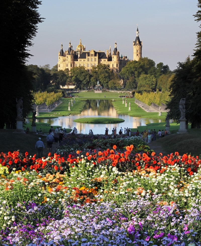 Castle Schwerin Germany across a bed of flowers