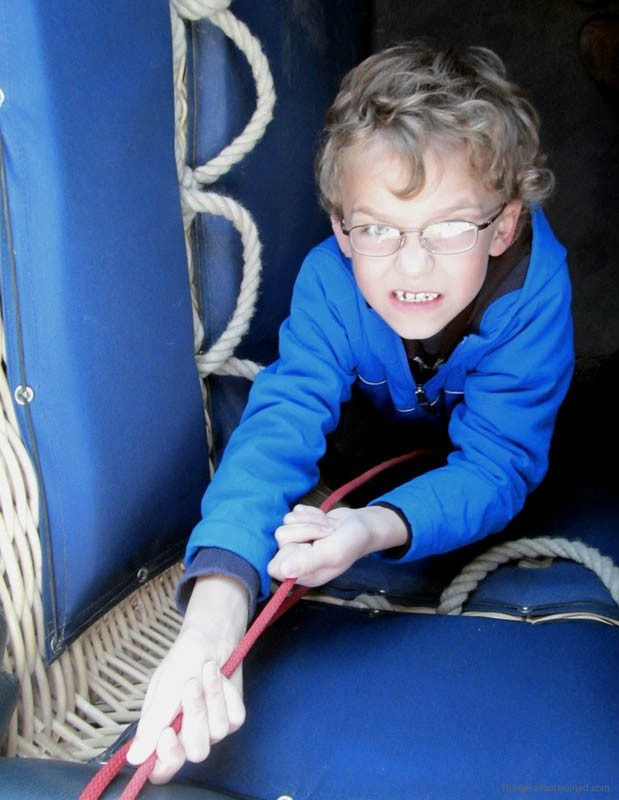 Child helping with the ropes hot air balloon