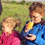Kids celebrating with a glass of oj