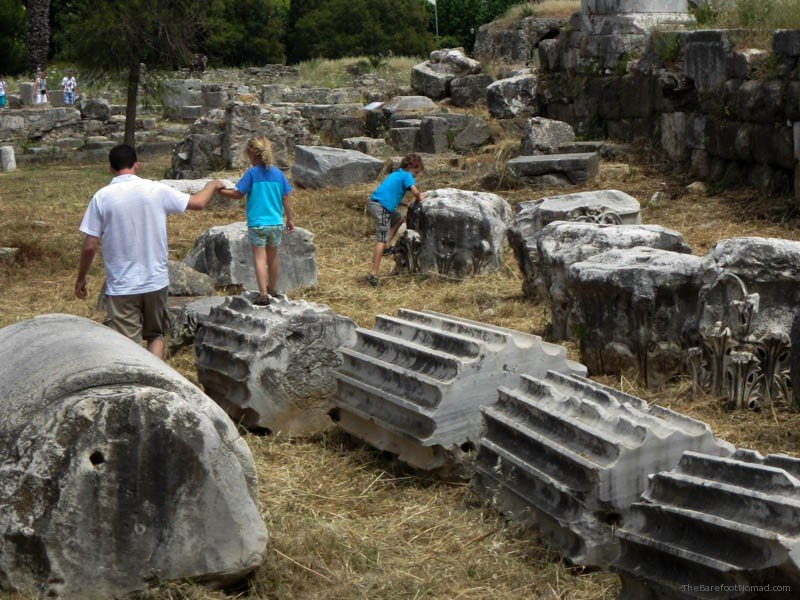 Kids playing on the fallen columns at the Kos Agora Greece
