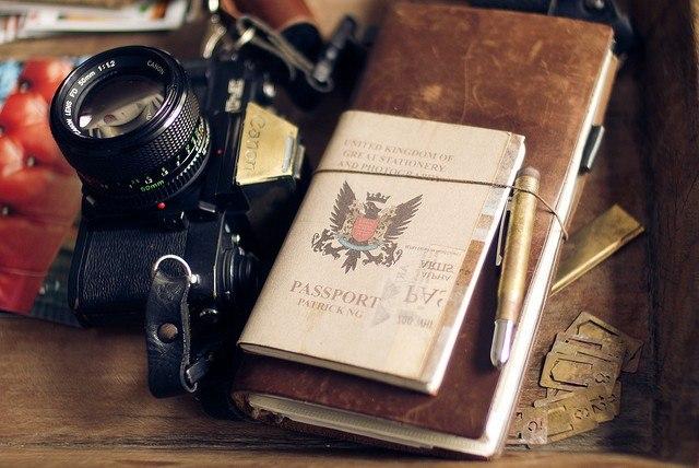 Camera and Passport by Patrick Ng