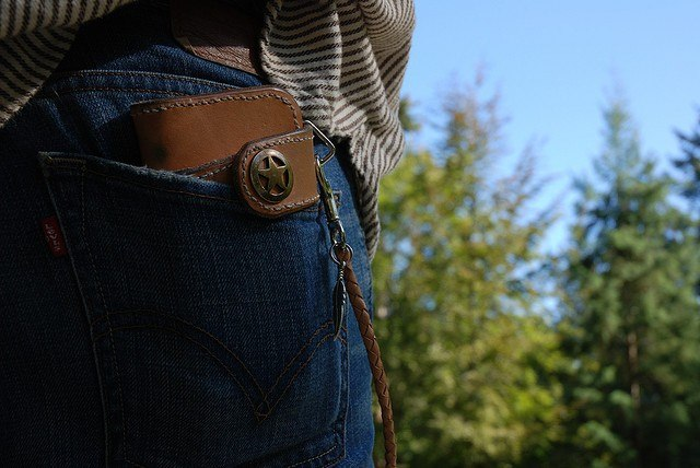 Wallet in back pocket save money by Laura Mason