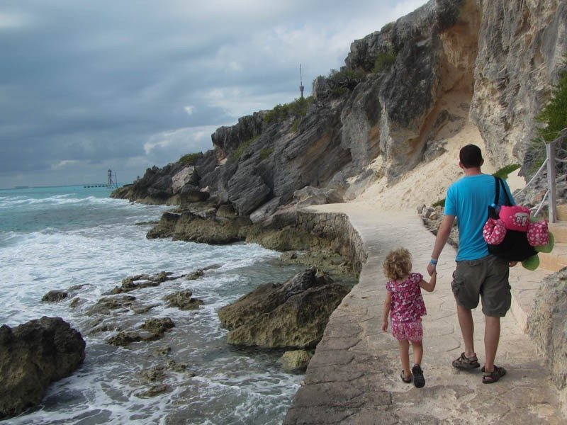 Daddy and Little Girl Walking by Ocean in Mexico