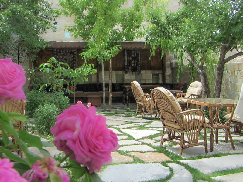 Elysee Cave Hotel Courtyard Roses in Foreground