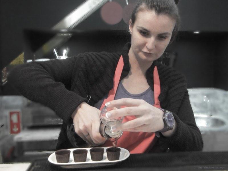 Pouring Ginjinha into chocolate cups Lisbon Portugal