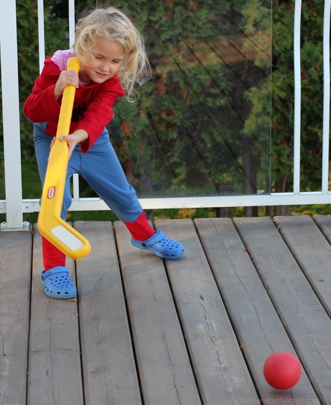 Playing hockey on the back deck