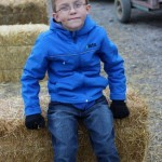 Cole on bales at the pumpkin patch