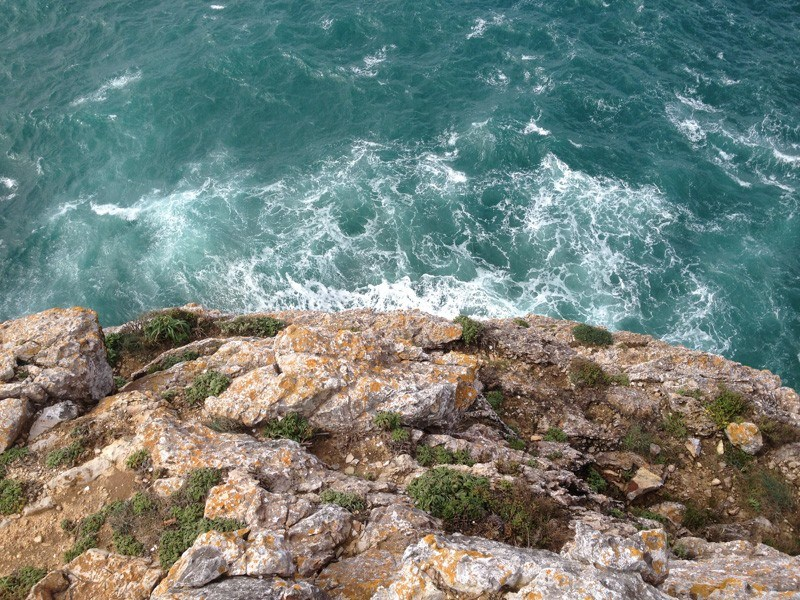 Overlooking a cliff on Sagres Point. It's a long way down