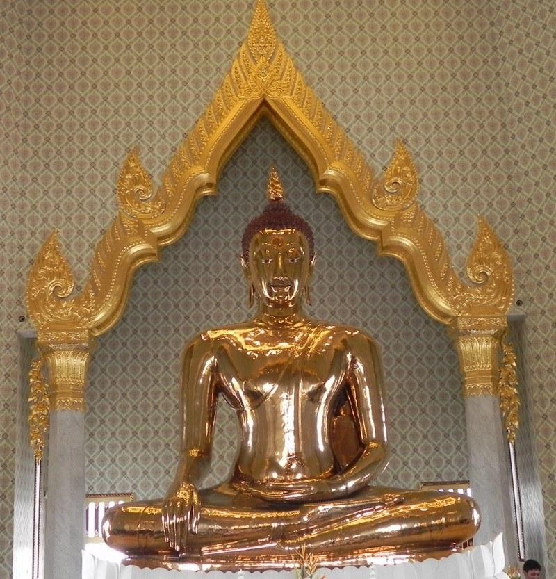 The Golden Buddha sitting on a pedestal
