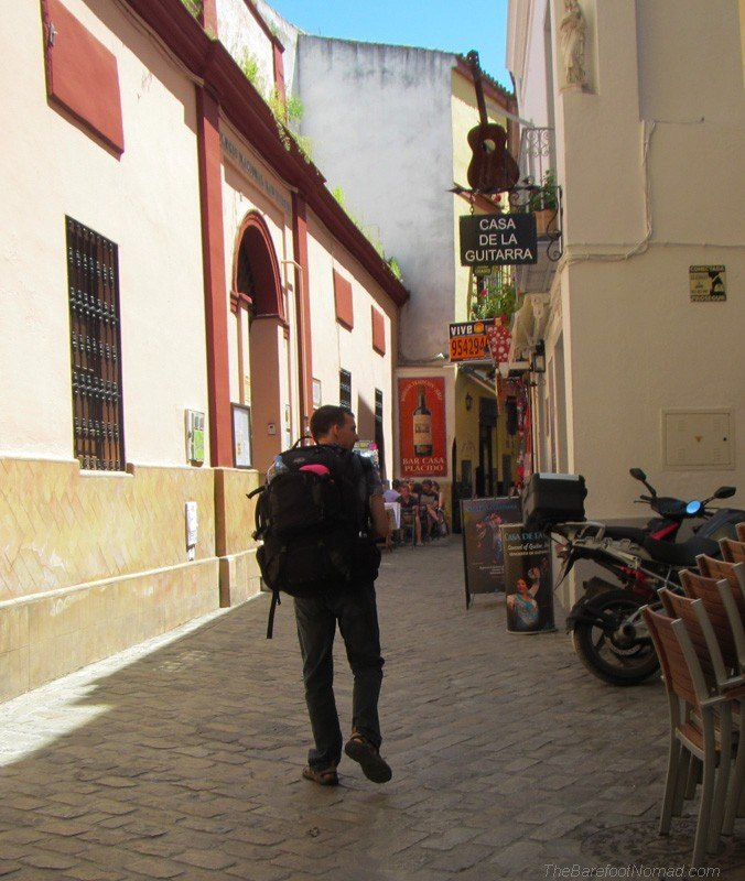 Charles walking by Apartamentos Las Cruces in Seville