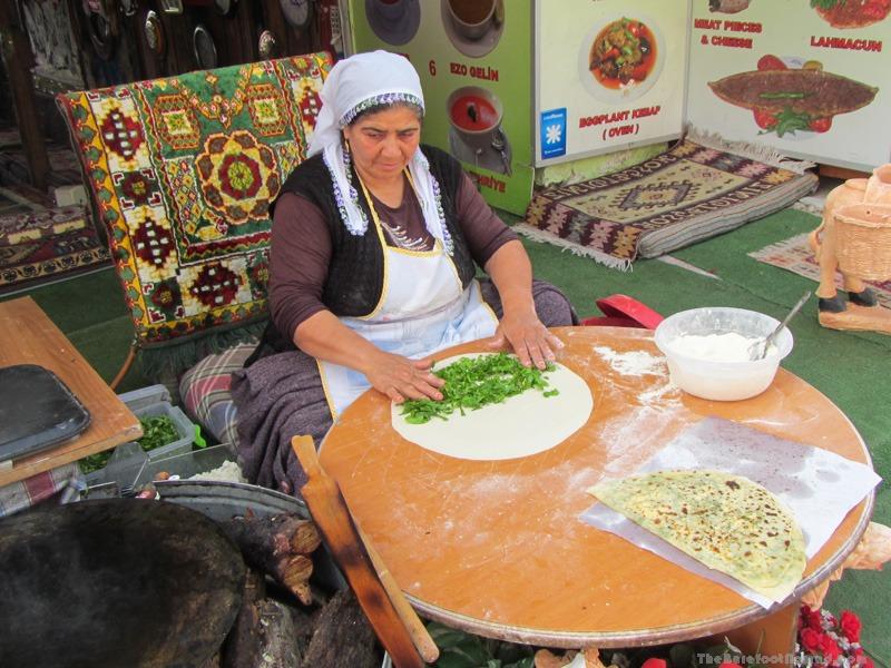 Woman makin borek by hand outside Yildiz Restaurant in Pamukkale