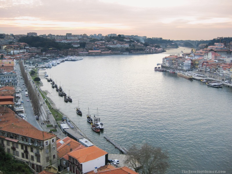 Boats lined up along Av. Diogo Leite on the Douro River in Porto, Portugal