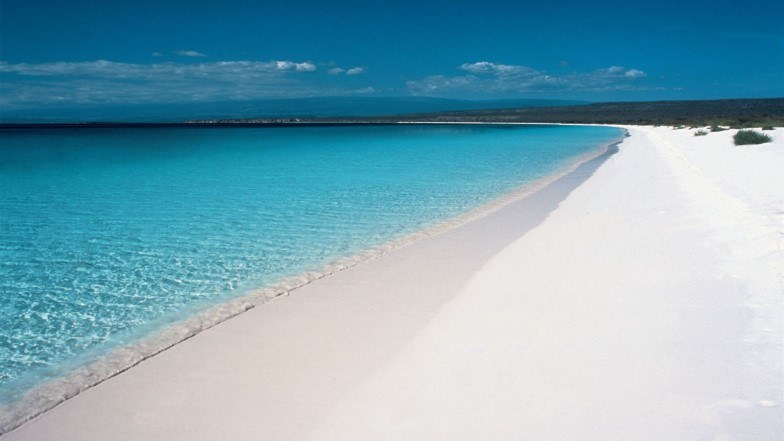 Blue water and unspoiled white sands of Bahia de las Guilas
