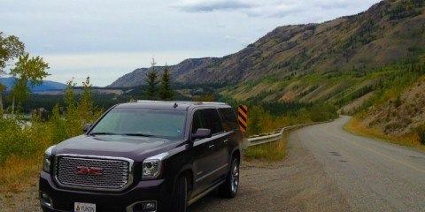 Black 2015 GMC Yukon Denali on a beautiful stretch of of the Klondike highway