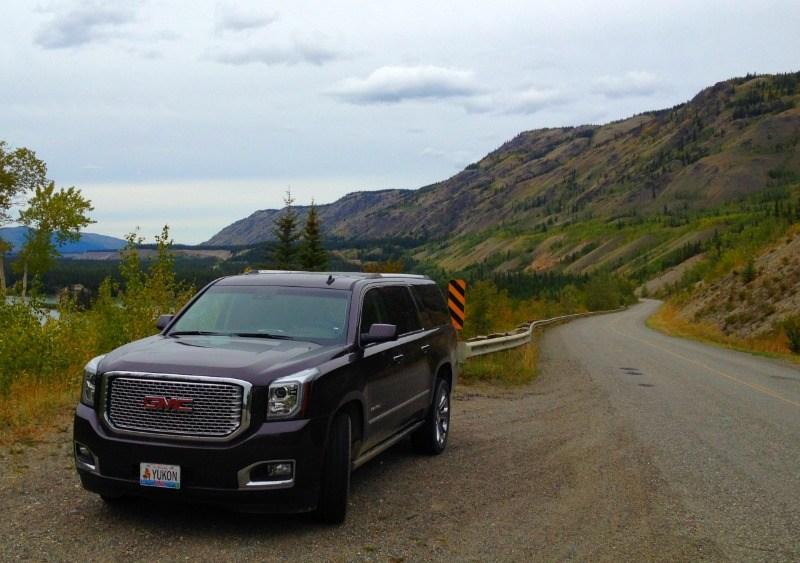 Black 2015 GMC Yukon Denali on a beautiful stretch of of the Klondike highway