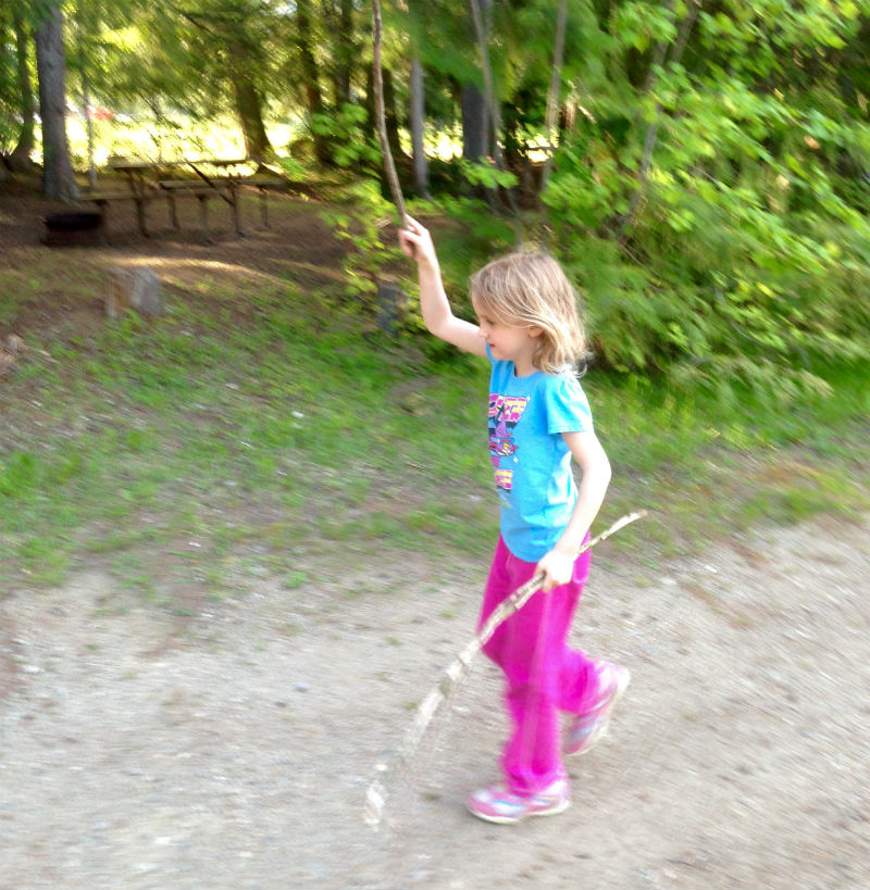 Playing with sticks in the forest Sicamous KOA