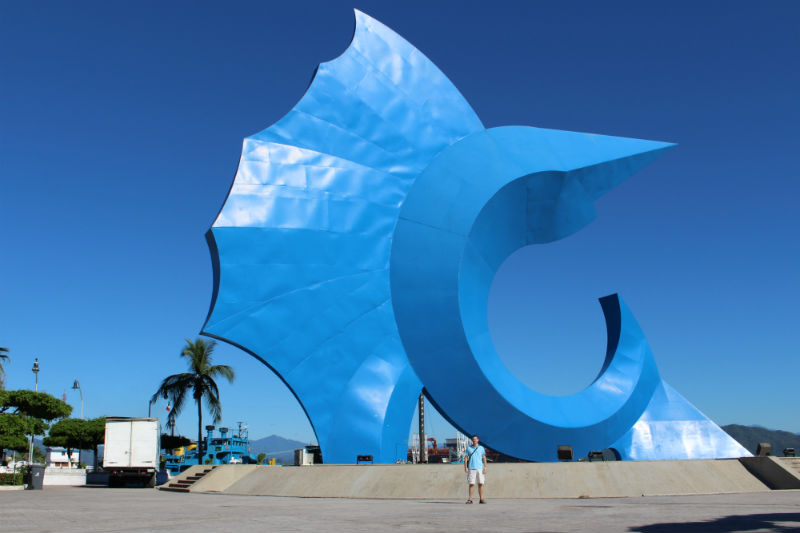 Charles Kosman in front of giant blue sailfish in Manzanillo, Mexico