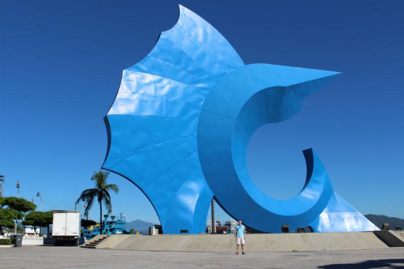 Charles Kosman in front of giant blue sailfish in Manzanillo, Mexico