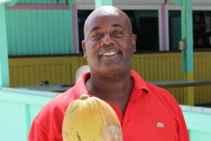 Anguilla Aclan offering up a coconut fresh from the tree