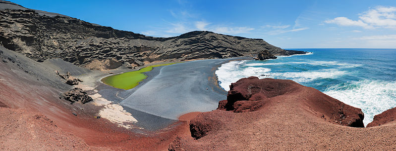 Panorama View of Charco de los Clickos with it's green water, red rock and black sand