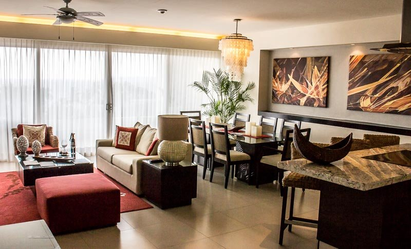 Living room and dining room in my two bedroom apartment in the luxury resort of Marival Residences