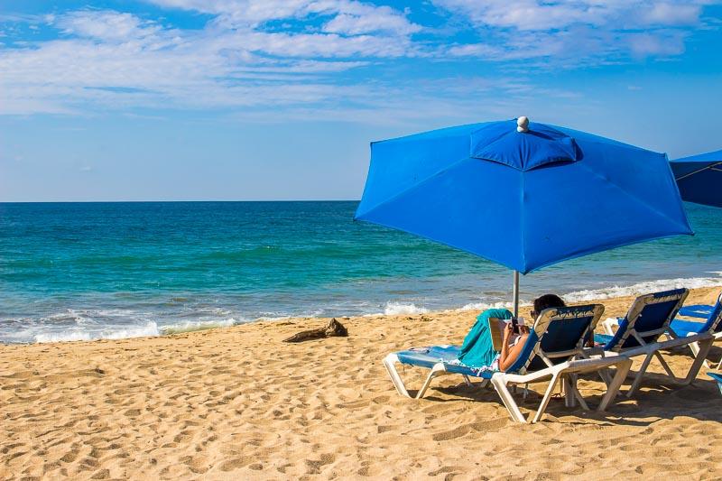 Beach And Woman On Sun Lounger San Pancho Mexico Riviera Nayarit