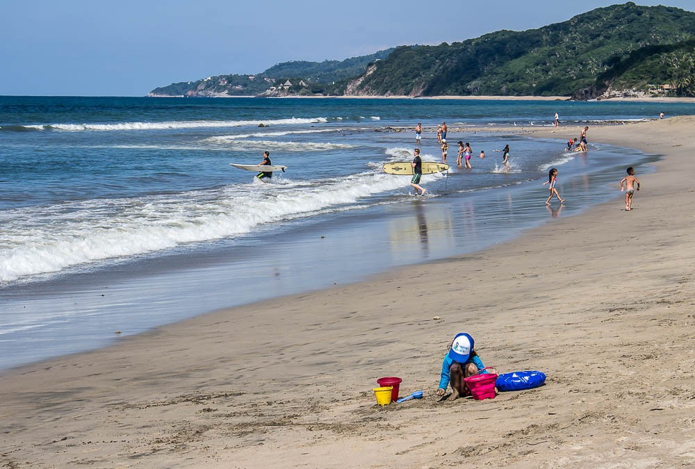 Sayulita Mexico beach sufer kids in sand what to do in the Riviera Nayarit