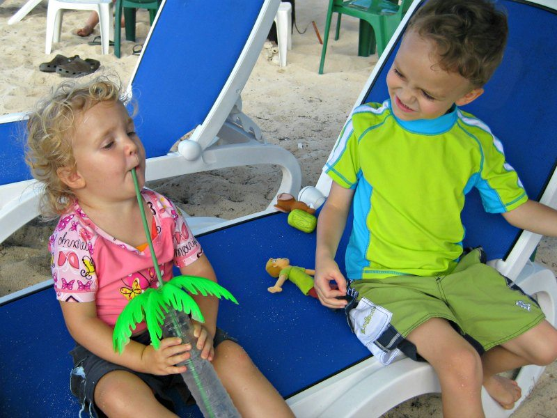 Kids enjoying an oversized drink in Cozumel at Carlos And Charlies